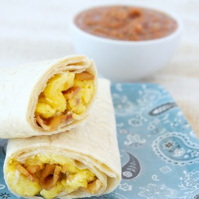 two meal prep egg and bacon burritos stacked