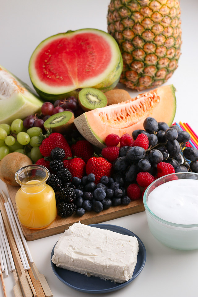 Fruit Kabobs and fruit dip ingredients on cutting board