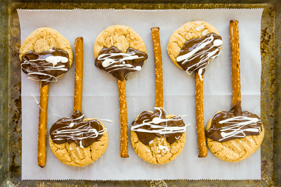 I love turning my simple Peanut Butter Cookie recipe into these fun Halloween Witches Broom Cookies.  Everyone loves a good chocolate and peanut butter dessert!