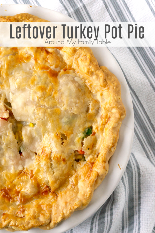One of the best ways to use up holiday leftover turkey is with an easy Leftover Turkey Pot Pie. Mixed vegetables, leftover turkey, and a creamy sauce mixed together and topped with a flaky pie crust turn leftover turkey into a delicious dinner. #leftoverturkey #christmastleftovers #thanksgivingleftovers #potpie #turkey via @slingmama