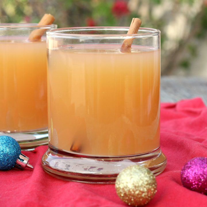 2 glasses filled with slow cooker Christmas wassail