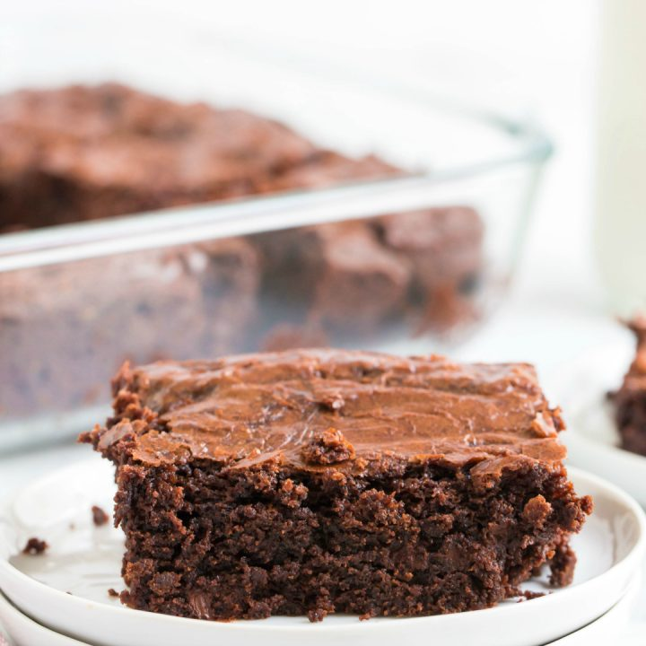 fudgy dark chocolate brownie on white plate