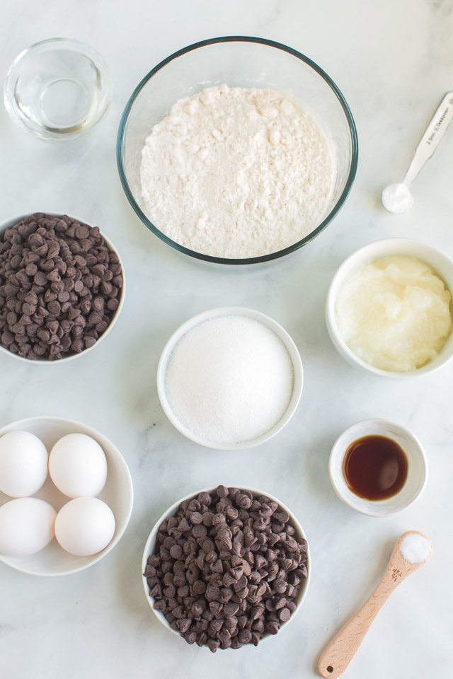 ingredients in bowls and measuring cups to make a healthier brownie recipe