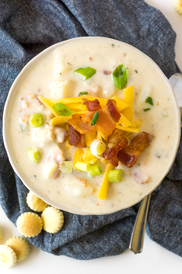 bowl of Boston clam chowder garnished with cheese and bacon