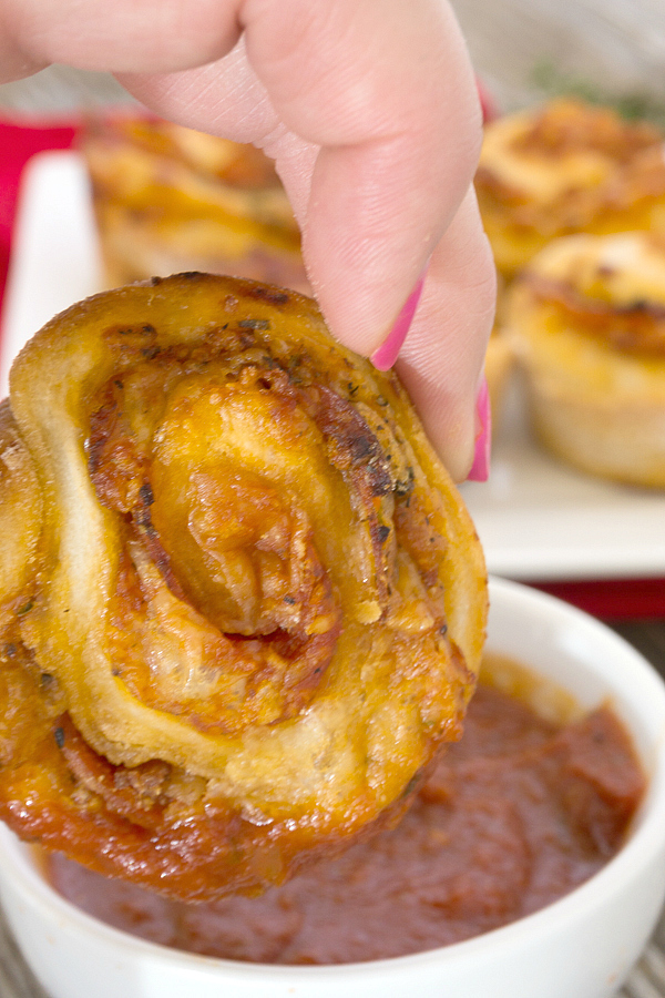 Pizza Muffins are everything you love about pizza rolled up and baked in a muffin tin for a portable lunch or snack!