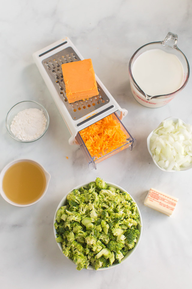 overhead photo: prepped ingredients on white counter to make cheddar broccoli soup recipe