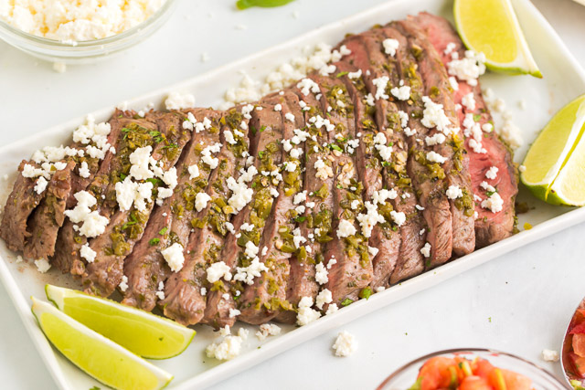 slices of Mexican steak sprinkled with Cojita cheese and lime wedges