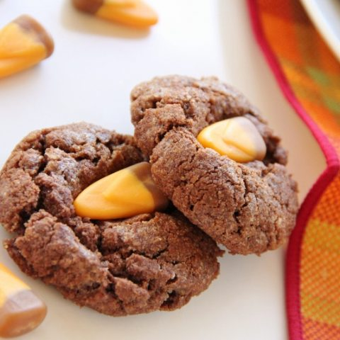 chocolate caramel cookies with candy corn on top