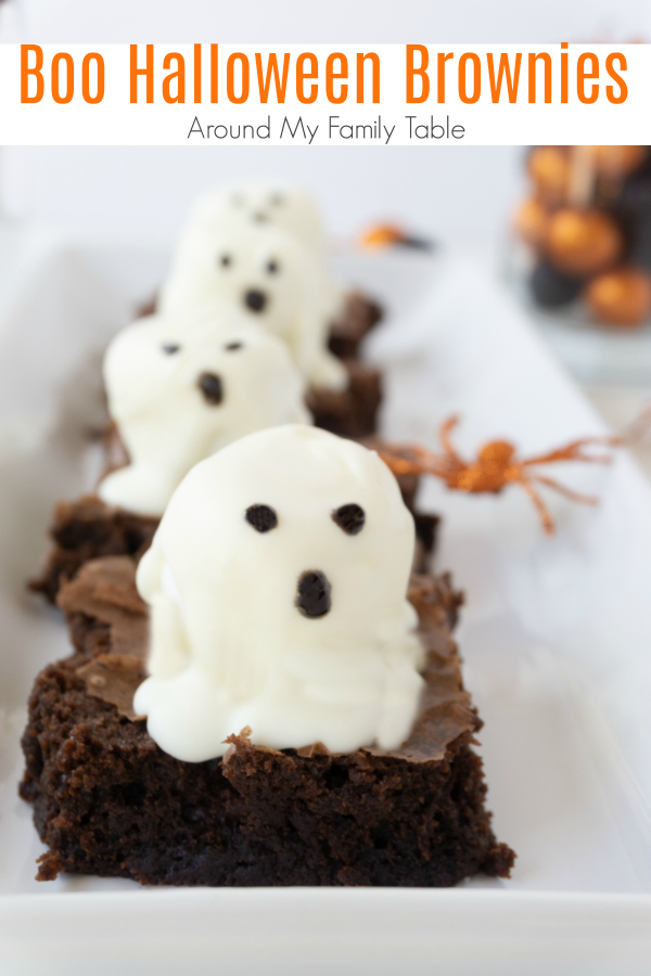 These Boo Halloween Brownies are the cutest. Made with white chocolate marshmallows on top of a delicious brownie....kids love making them as much as they love eating them. #halloween #halloweendesserts #halloweentreats #brownies via @slingmama