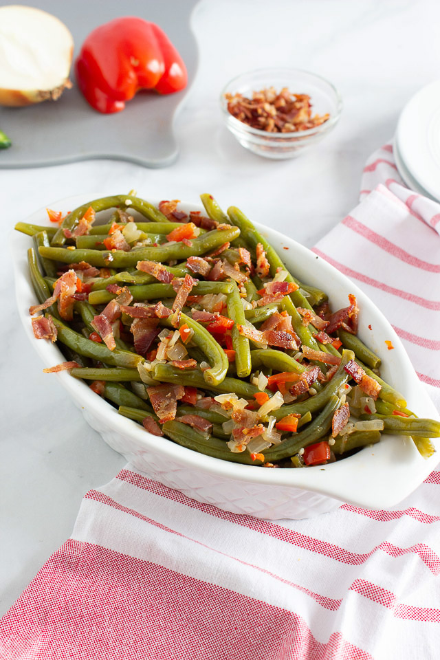 copycat version of Famous Dave's green beans in a white serving dish