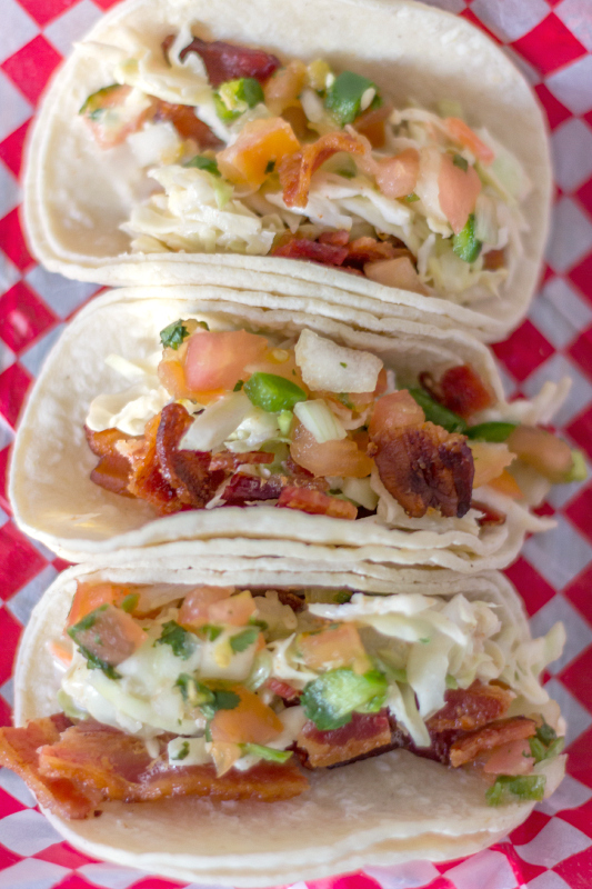 Everything you love about tacos, only better because they are filled with bacon!  Try these BACON TACOS for the next Taco Tuesday. #tacos #bacon #tacotuesday via @slingmama