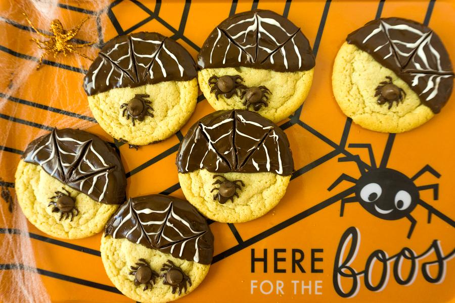 spider cookies on orange platter
