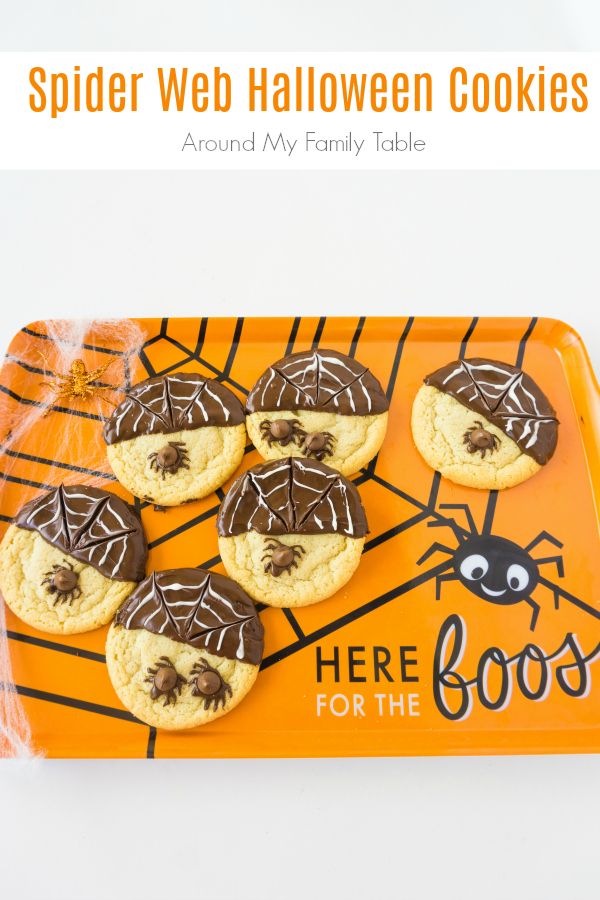 These Spider Web Halloween Cookies are easy and festive. Perfect for kids to create, a Halloween party, or for school treats. #halloween #halloweenrecipes #cookies #halloweencookies #spiders via @slingmama