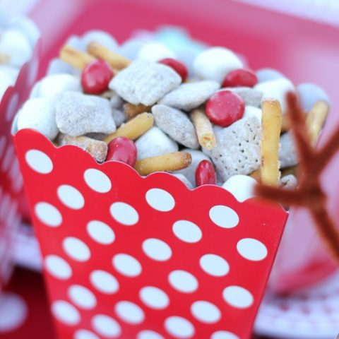 Christmas Snack Mix in a red and white polka dot popcorn box