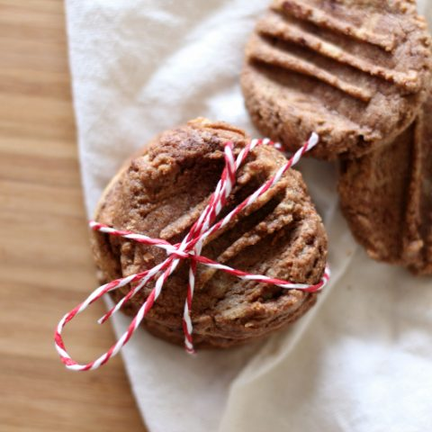 Flourless Chocolate Peanut Butter Cookies tied with twine into a stack