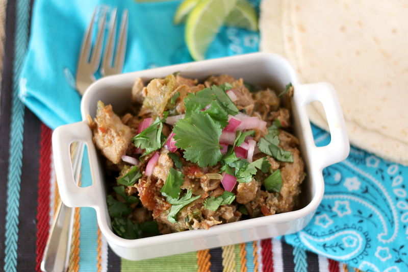 A big bowl of Green Chile Pork Stew doesn't need anything else to make it amazing, but I love serving it with chips or with some tortillas and fresh lime wedges.