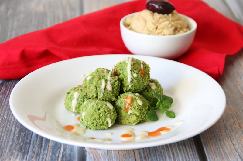 Pea-Afel (Vegan Falafel) on a white plate with hummus