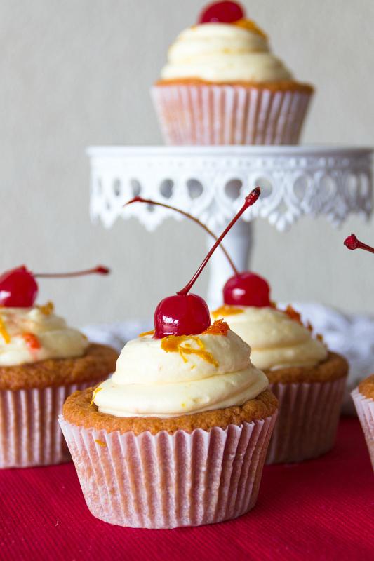 Tequila Sunrise Cupcakes-- a grenedine cupcake with tequila orange buttercream