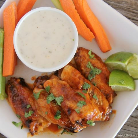 Honey Sriracha Chicken Wings on a platter with ranch dressing