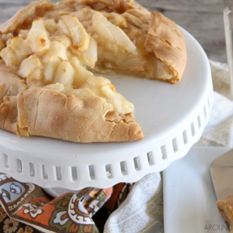 rustic pear tart on a cake stand