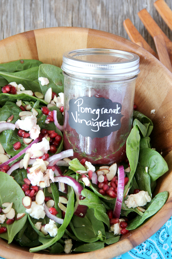 Lighten up with a bowl of POMEGRANATE AND GOAT CHEESE SALAD with an easy and delicious homemade Pomegranate Vinaigrette!