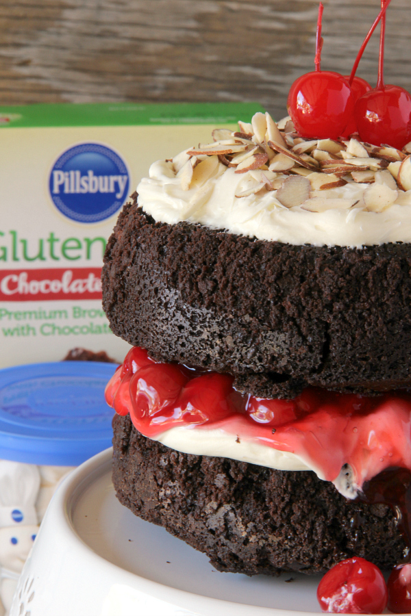 You will never make a plain box of brownies again once you make this stunning BLACK FOREST BROWNIE CAKE with the flavors and look of a traditional Black Forest Cake, but with a decadent chocolate fudge brownie.
