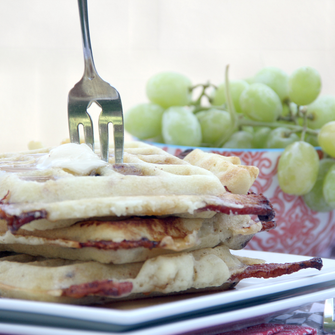 Change up your morning waffles and stuff them with bacon! These BACON STUFFED WAFFLES are the perfect sweet & salty breakfast blend!