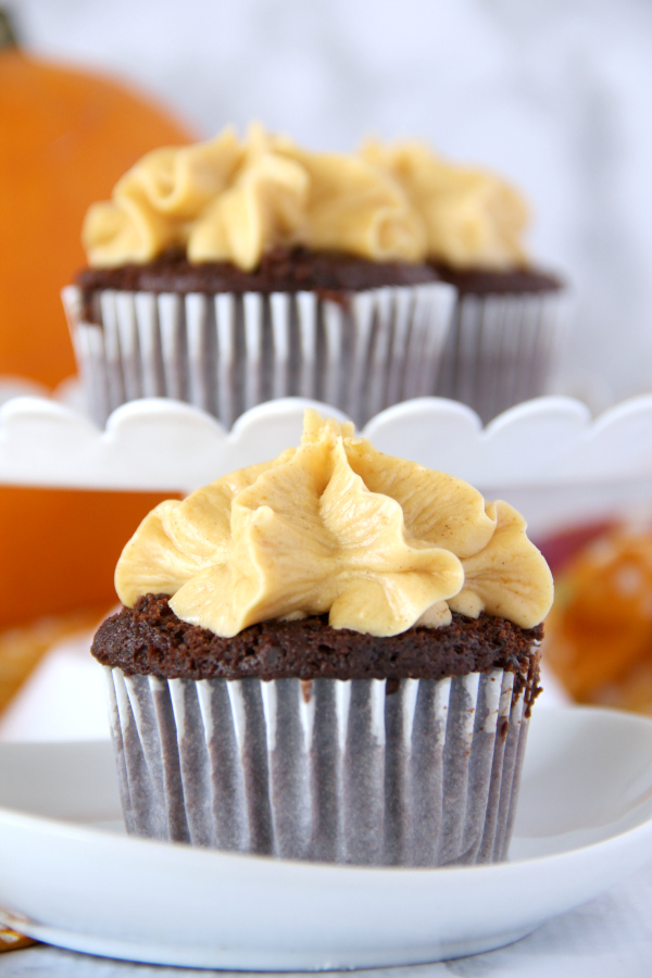 Fall has never tasted so good! Once you try one of these dreamy Chocolate Cupcakes with Pumpkin Buttercream Frosting you'll be reachin' for a second one.