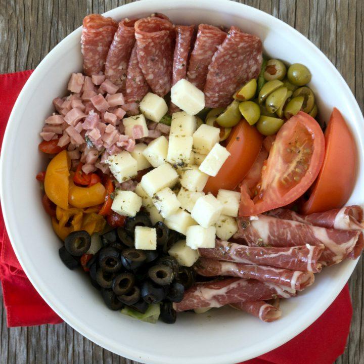 muffaletta salad in a white bowl