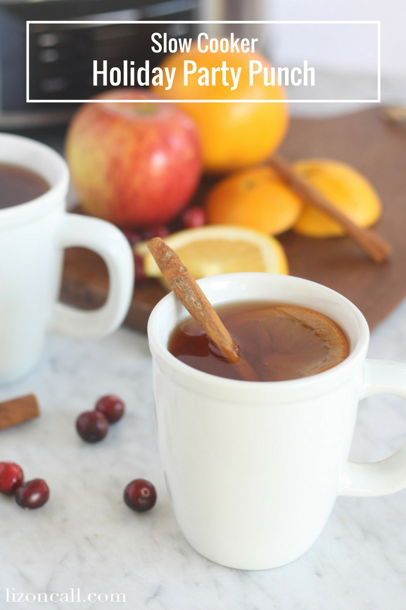Slow Cooker Party Punch in white mugs
