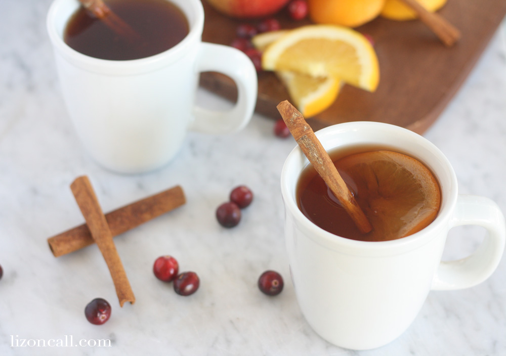 two white mugs filled with slow cooker party punch