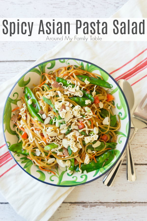 Change up your traditional summer pasta salad for this Spicy Asian Pasta Salad, it will be the hit of all your summer parties! This pasta salad is full of fresh vegetables and topped with some crushed ramen noodles and slivered almonds. #pastasalad