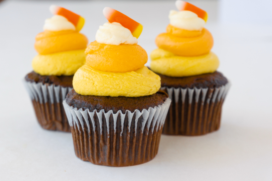 Turn the classic candy corn into these cute and easy Halloween Candy Corn Cupcakes, ideal for class parties or any spooky event.