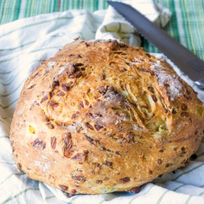 This Rustic Green Chile Cheese Bread is such an easy bread to make and has such great flavor from the cheese and chiles and such a nice texture.  Cooking it without a pan and in a wood fired pizza oven gives it a rustic feel.
