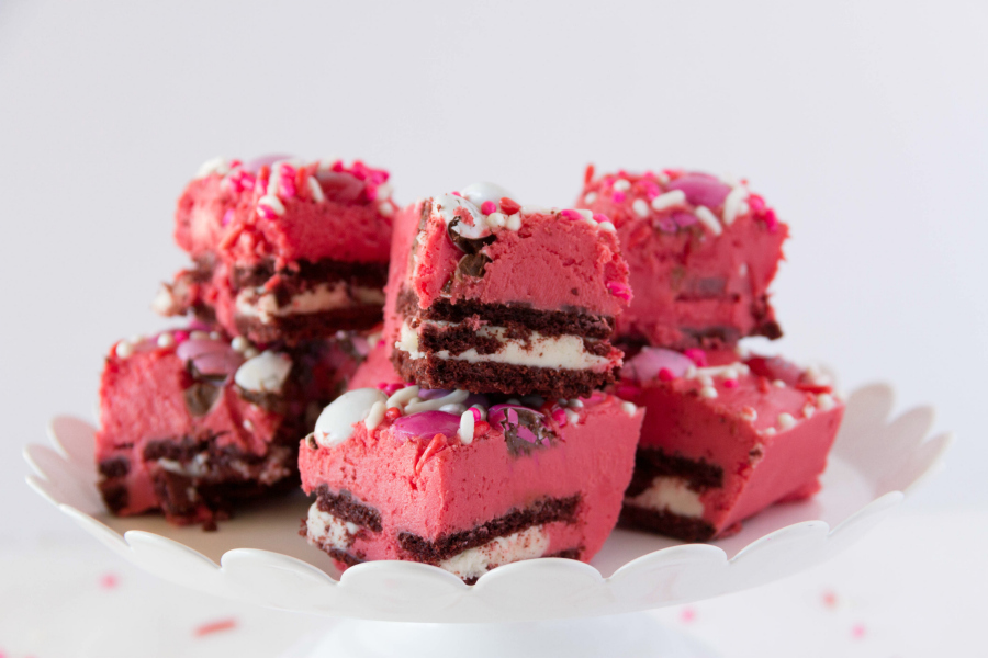 This Red Velvet Fudge is layered with chocolate sandwich cookies and loads of Valentine chocolates and sprinkles. It's a simple gourmet fudge recipe that is festive and delicious.