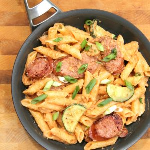 This spicy Sriracha Cream Sauce with Kielbasa is total comfort food and is on the table in under 30 minutes, including the pasta!