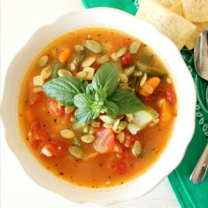 A big bowl of Summer Vegetable Soup is the perfect way to use all those summer vegetables that are overflowing in your garden and at the farmer's market.