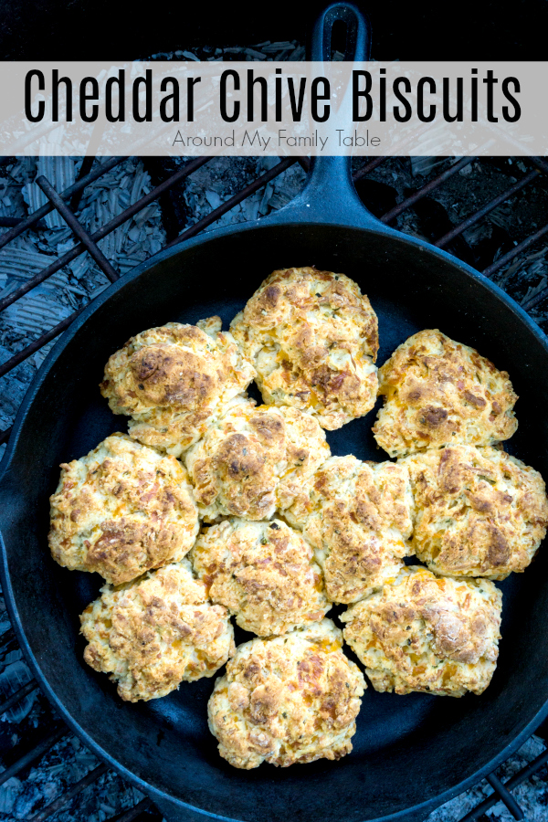 I've kicked up my traditional buttermilk biscuits and added loads of cheddar and chives.  My Cheddar Chive Biscuits are absolutely mouth watering whether cooked in the oven or over a campfire. #castiron #campingrecipes #camping #biscuits #cheedarchive #dropbiscuits #castironrecipes via @slingmama