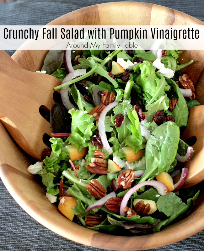 This Crunchy Fall Salad is a refreshing fall salad for the holidays that's been tossed in an unbelieveale Pumpkin Vinaigrette. via @slingmama