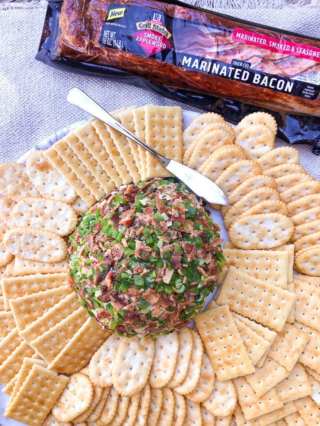 Jalapeño Bacon Cheese Ball on a white platter with crackers