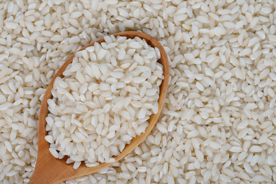 dried arborio rice with wooden spoon