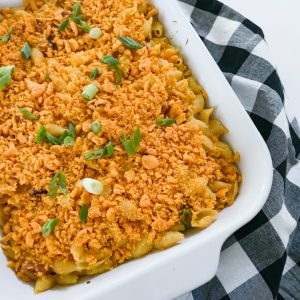 Baked Ham & Cheese Pasta Casserole in white pan with checkered napkin