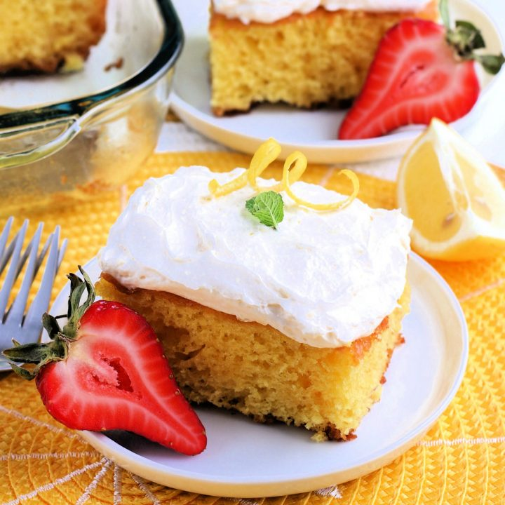 lemonade cake slices on white plates and yellow placement