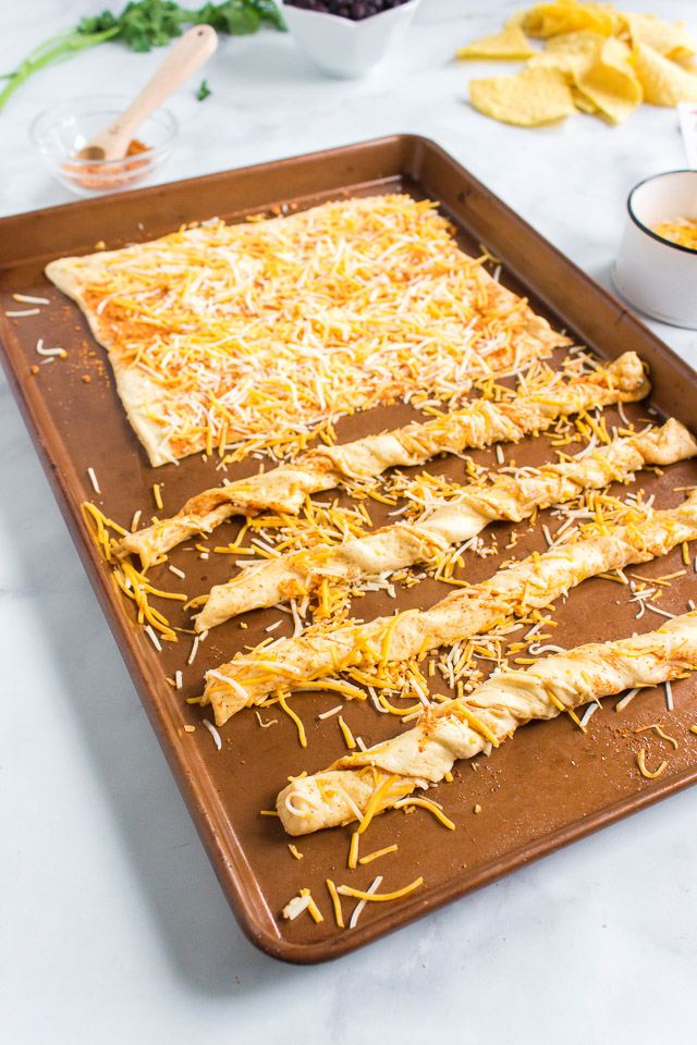 uncooked southwestern cheese breadsticks on baking sheet