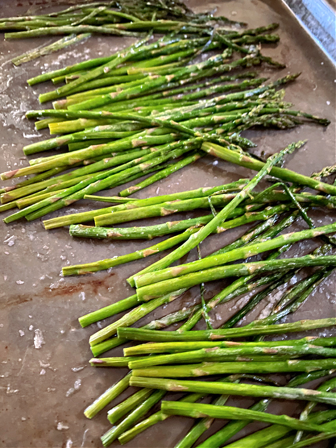 cooked asparagus on a sheet pan