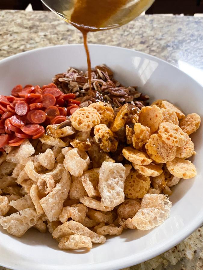 adding seasoning to Low Carb Keto Snack Mix