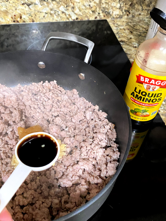 cooking keto egg roll in a bowl