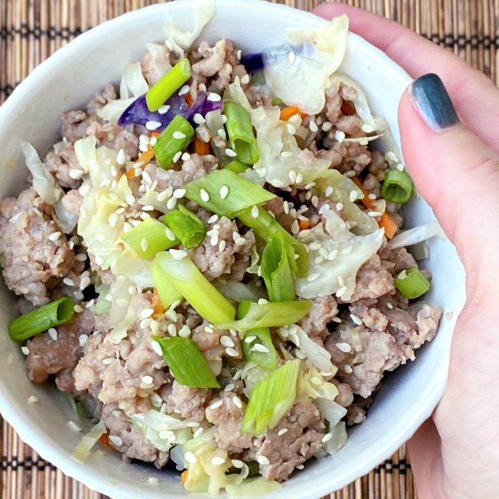hand holding keto egg roll in a bowl